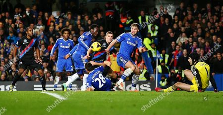 Crystal Palace's Stuart O'Keefe attempt on goal is denied by Chelsea's Branislav Ivanovic