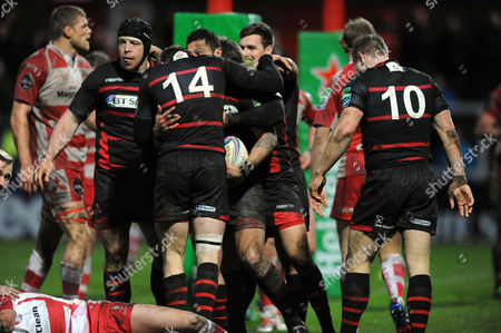 Ben Atiga - Edinburgh centre celebrates with his team mates after his match winning try.