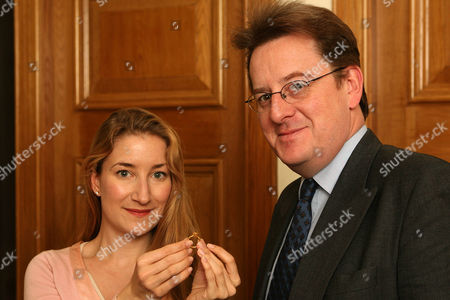 Editorial image of Robert Hardman And Helen Molesworth Of Christies With A Ring Found At Manley Hall Cheshire. Treasure Hunter John Wood Was Baffled By A Mysterious Code Engraved On The Ring But Now The Riddle Has Been Deciphered And The 650-year-old Piece Of Jewellery