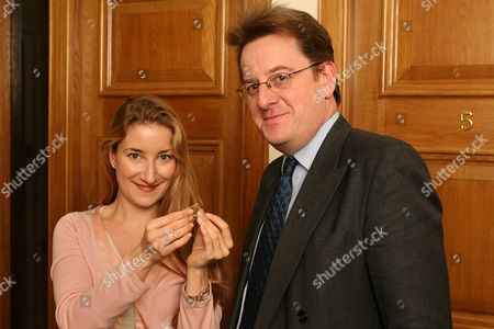 Robert Hardman And Helen Molesworth Of Christies With A Ring Found At Manley Hall Cheshire. Treasure Hunter John Wood Was Baffled By A Mysterious Code Engraved On The Ring But Now The Riddle Has Been Deciphered And The 650-year-old Piece Of Jewellery Could Be Worth Ii100 000.