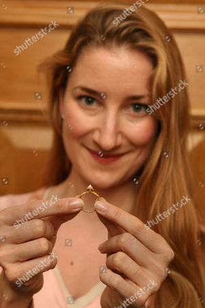 Editorial photo of Helen Molesworth Of Christies With A Ring Found At Manley Hall Cheshire. Treasure Hunter John Wood Was Baffled By A Mysterious Code Engraved On The Ring But Now The Riddle Has Been Deciphered And The 650-year-old Piece Of Jewellery Could Be Worth Ii1
