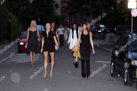 England 2006 World Cup Football Squad Wives And Girlfriends On Their Way To Dinner At Medici Restaurant In Baden-baden Germany. Lisa Roughead Left Girlfriend Of Michael Carrick Louise Owen Front Left Wife Of Michael Owen And Carly Zucker Front Right Girlfriend Of Joe Cole Lead The Group. Behind Carly Is Vanessa Perroncel White Dress Girlfriend Of Wayne Bridge. Joe Cole And Carly Zucker Were Married In June 2009.