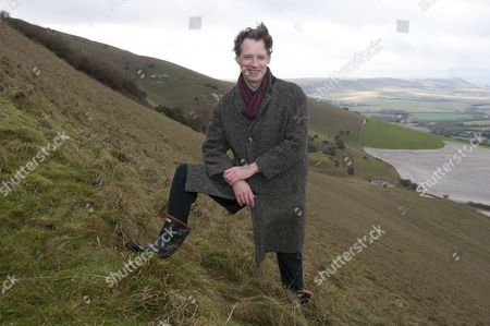 Alexander Masters At The Scene Of His 'roly Poly' Accident On The Southdowns Over Looking The 'long Man' Near Wilmington East Sussex.