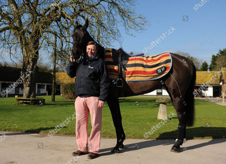 Cheltenham Festival Preview. Nick Henderson Lambourn Stables Pictured Nicky Henderson With Racehorse Grandouet.