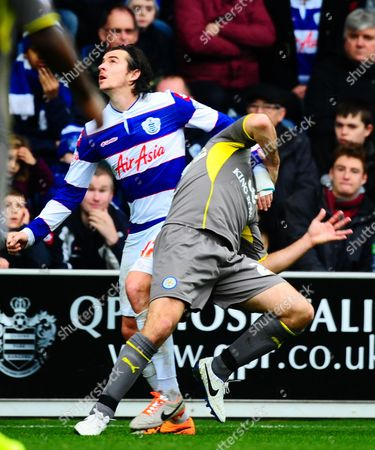 Caption correction - Joey Barton of QPR tangles with Gary Taylor-Fletcher of Leicester City leading to his first of two quick fire yellow cards