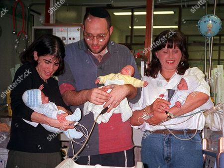 Editorial picture of Anthony Cohn And Julie Cohn With Their Triplet Baby Boys Which Were Carried By Surrogate Mother Anne Keep (r) 1997.
