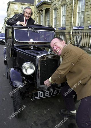 JACKIE STEWART WITH STAGECOACH OWNER BRIAN SOUTER WHO HAS DONATED HIS 1932 AUSTIN 7 TO BE AUCTIONED AT PHILLIPS IN EDINBURGH IN AID OF THE PRINCESS ROYAL TRUST FOR CARERS