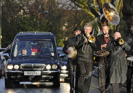 Stock Image of The hearse following behind a brass band