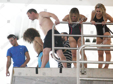 Tom Daley points to the water 10 metres below as Perri Kiely   Ricky Groves Michaela Strachan and Gemma Merna look on