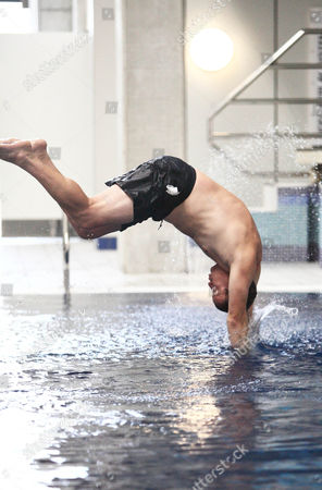 Ricky Groves dives from the side of the pool