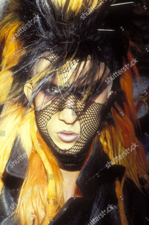 Martin Degville of Sigue Sigue Sputnik, wearing stacked wigs and a stocking over his face. London, 1986