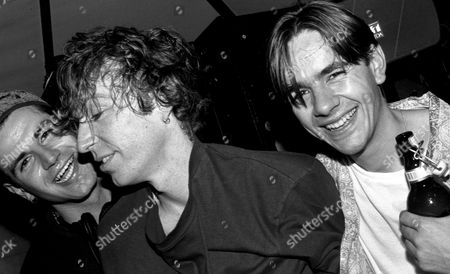 L-R, DJs Jon da Silva, Mike Pickering and Laurent Garnier hangout in the DJ booth at HOT at the Hacienda, Manchester 1988