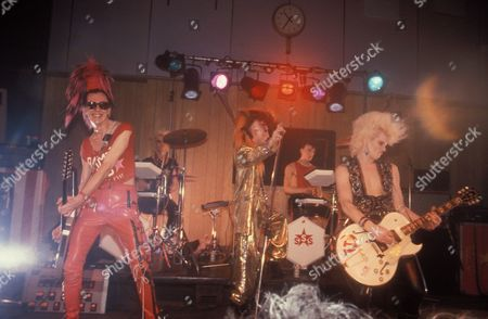 Cyber Punk band, Sigue, Sigue Sputnik, with Martin Degville playing instruments on stage, 1980s