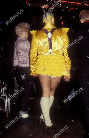 Stock Picture of LEFT: DJ Jeffrey Hinton, wearing Body Map jeans beside RIGHT: performance artist Leigh Bowery, wearing a yellow outfit, Taboo, London, UK, 1986