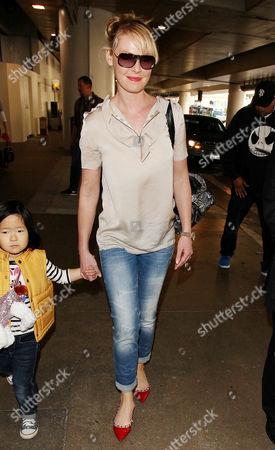 Editorial image of Katherine Heigl and daughter Nancy Leigh Kelley arriving at the Los Angeles International Airport, America - 08 Jan 2014