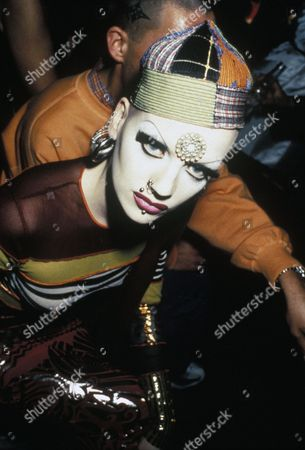 Polly, a woman with extreme make-up and piercings, Clubbing 1990s