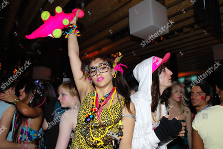 Stock Image of Namalee Bolle and a guy wearing New Rave styles, Anti-Social, London December 2006