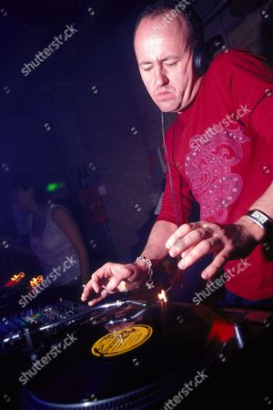 DJ Danny Rampling DJing at World DJ Day Fabric London March 2002