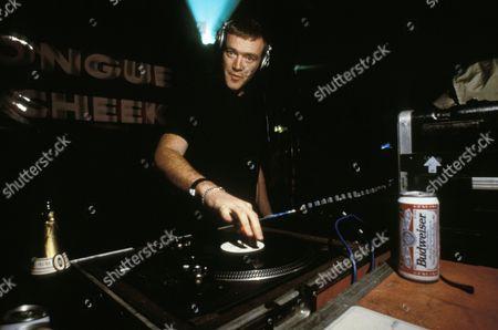 Tall Paul DJing at May day Ball, Oxford, UK 2000s.