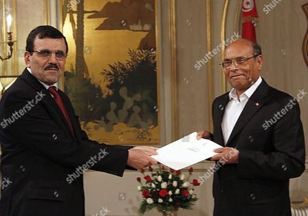 Tunisian Prime Minister Ali Laarayedh submits his resignation to President Moncef Marzouki at the Carthage Palace