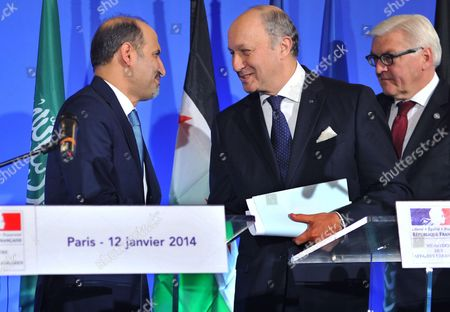 Ahmad Jarba (L), the leader of Syrian opposition National Coalition, shakes hands with French Foreign Affairs Minister Laurent Fabius