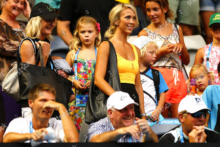 Rebecca Cartwright, wife of Lleyton, smiles with her children during The Australian Open, 2014