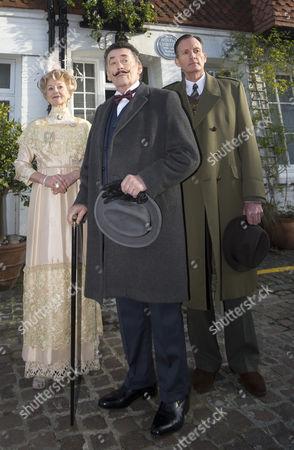 Liza Goddard as Miss Caroline Amory, Robert Powell as Hercule Poirot and Robin McCallum as Captain Arthur Hastings