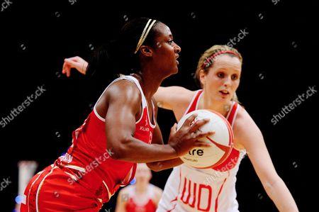 Sasha Corbin of England Netball passes the ball