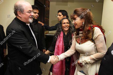Author Salman Rushdie shakes hands with Sunanda Pushkar as director Deepa Mehta looks on