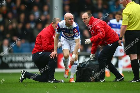 Queens Park Rangers' Andy Johnson receives medical support