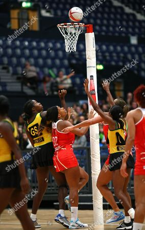Eboni Beckford Chambers competes for the ball with Jhaniele Fowler (L) and Shanice Beckford of Jamaica