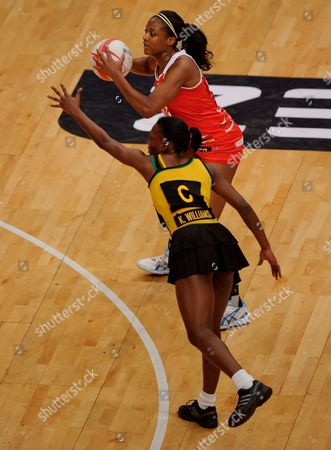 Sasha Corbin of England netball is guarded by Khadijah Williams of Jamaica