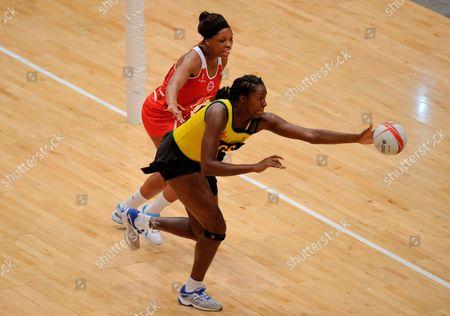 Eboni Beckford Chambers of England Netball and Jhaniele Fowler of Jamaica