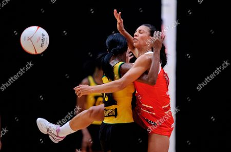 Stacey Francis of England Netball collides with Paula Thomspn of Jamaica Netball