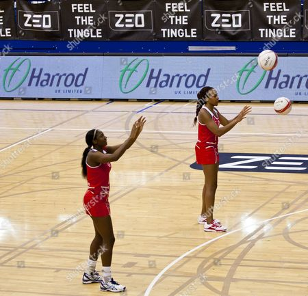 Pamela Cookey and Sasha Corbin warm up with prominent Harrod UK Limited branding