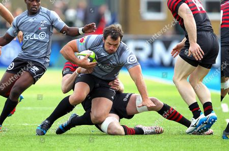 Sharks' Bismarck du Plessis (Captain) is tackled by Saracens' Mouritz Botha
