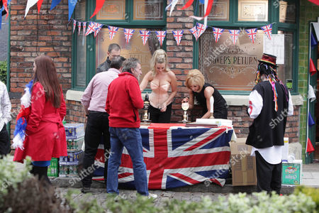 Coronation Street - Ep 7882 Monday 4 June 2012 at 7.30pm Stella Price [MICHELLE COLLINS] as Dusty Springfield serves with Eva Price [CATHERINE TYLDESLEY] dressed as Madonna.