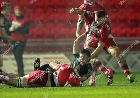 A scuffle between Richard Kelly of Scarlets and Jonny Hill and Ross Moriarty of Gloucester