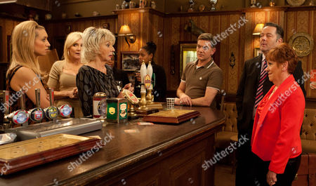 Stock Photo of Coronation Street - Ep 8072 Friday 1 March 2013 - 1st Episode Gloria Price [SUE JOHNSTON] is excited when Eric's solicitor calls at the pub to discuss his will. But when he arrives with a woman called Doris (HELEN FRASER] in tow it appears Eric may not have been everything he seemed. Will Gloria inherit Eric's wealth?
