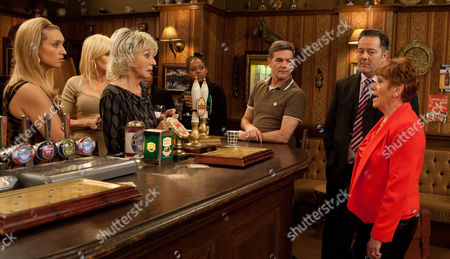 Stock Image of Coronation Street - Ep 8072 Friday 1 March 2013 - 1st Episode Gloria Price [SUE JOHNSTON] is excited when Eric's solicitor calls at the pub to discuss his will. But when he arrives with a woman called Doris (HELEN FRASER] in tow it appears Eric may not have been everything he seemed. Will Gloria inherit Eric's wealth?