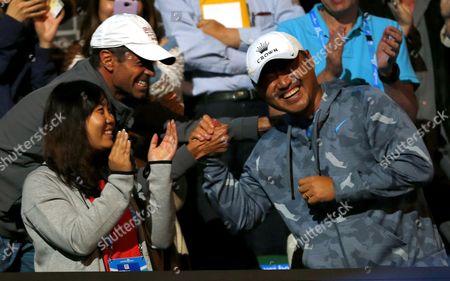 Stock Photo of Jiang Shan, husband of Li Na of China laughs during the Ladies Final at The Australian Open, 2014