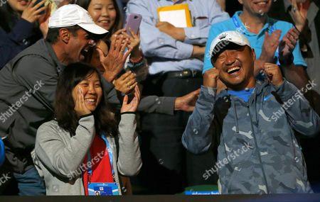 Jiang Shan, husband of Li Na of China laughs during the Ladies Final at The Australian Open, 2014