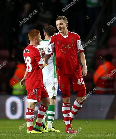 Sam Gallagher of Southampton (right) celebrates with team mate Harrison Reed at full time