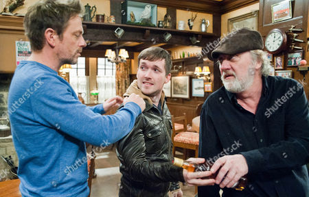 Emmerdale - EP 6511 Wednesday 27 March 2013 Cameron Murray [DOMINIC POWER] throws Robbie Lawson [JAMIE SHELTON] out of the pub after he blatantly sells scotch to Zak Dingle [STEVE HALIWELL]. Robbie threatens Cameron, if he hurts him, he hurts Debbie and in turn that means he will hurt Sarah too. Cameron warns Robbie to stay away from both Chas and Sarah Picture contact: david.crookatitv.com on 0161 952 6214