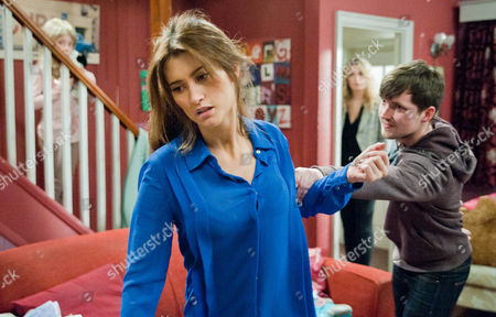 Stock Picture of Emmerdale - 6571 Wednesday 5 June 2013 Full of fury and confusion Robbie Lawson [JAMIE SHELTON] lunges violently at Debbie Dingle [CHARLEY WEBB] just as Charity Sharma [EMMA ATKINS] walks in and separates the pair. Charity is appalled Sarah Sugden [SOPHIA AMBER MOORE] is within earshot and has been exposed to such violence and other recent dangerous events.