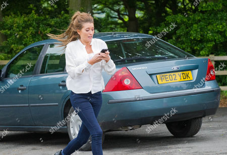 Emmerdale - Ep 6615 Thursday 25 July 2013 - 2nd Ep After a standoff at the garage Gennie Sharma [SIAN REESE-WILLIAMS] revs up her car and escapes with Debbie Dingle [CHARLEY WEBB] and Cameron Murray [DOMINIC POWER] in hot pursuit in Debbie's car. New driver Gennie is panicking behind the wheel. Under the pressure and with her mobile out of reach she is full of fear what to do next. Behind her Debbie is emphatic they have to stop her and they keep up the chase. Panicking Gennie loses control of the car screaming as she careers off the road and her car tumbles down the ravine. With no mobile reception Debbie and Cameron rush to the road railings and Debbie calls for an ambulance. With the car crumpled in the bottom of the ravine it is not looking good for Gennie...