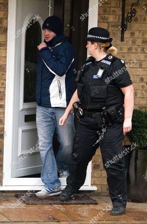 Dean Hancock is taken away by police