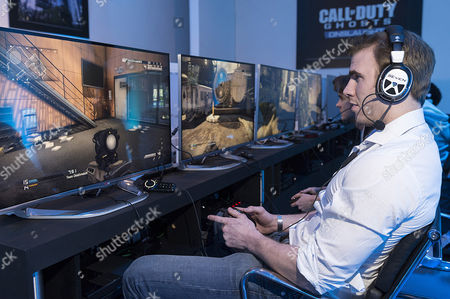 Stock Photo of French rugby union player Fabrice Estebanez and English rugby union player Tom Croft enjoying the Call of Duty: Ghosts Onslaught launch party.