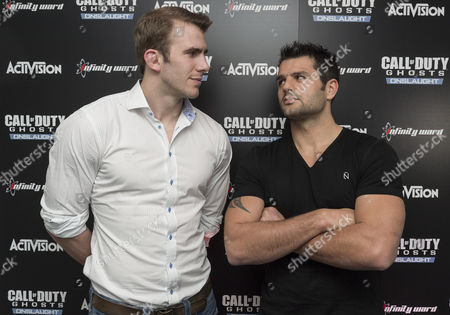 Stock Image of English rugby union player Tom Croft and French rugby union player Fabrice Estebanez enjoying the Call of Duty: Ghosts Onslaught launch party.