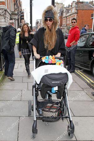 Katie Price with baby son Jett in a pushchair with son Jett Riviera